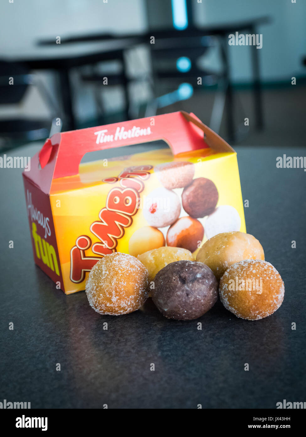 Timbits (donut holes, doughnut holes) from Tim Hortons, a popular Canadian fast food restaurant chain. - Stock Image