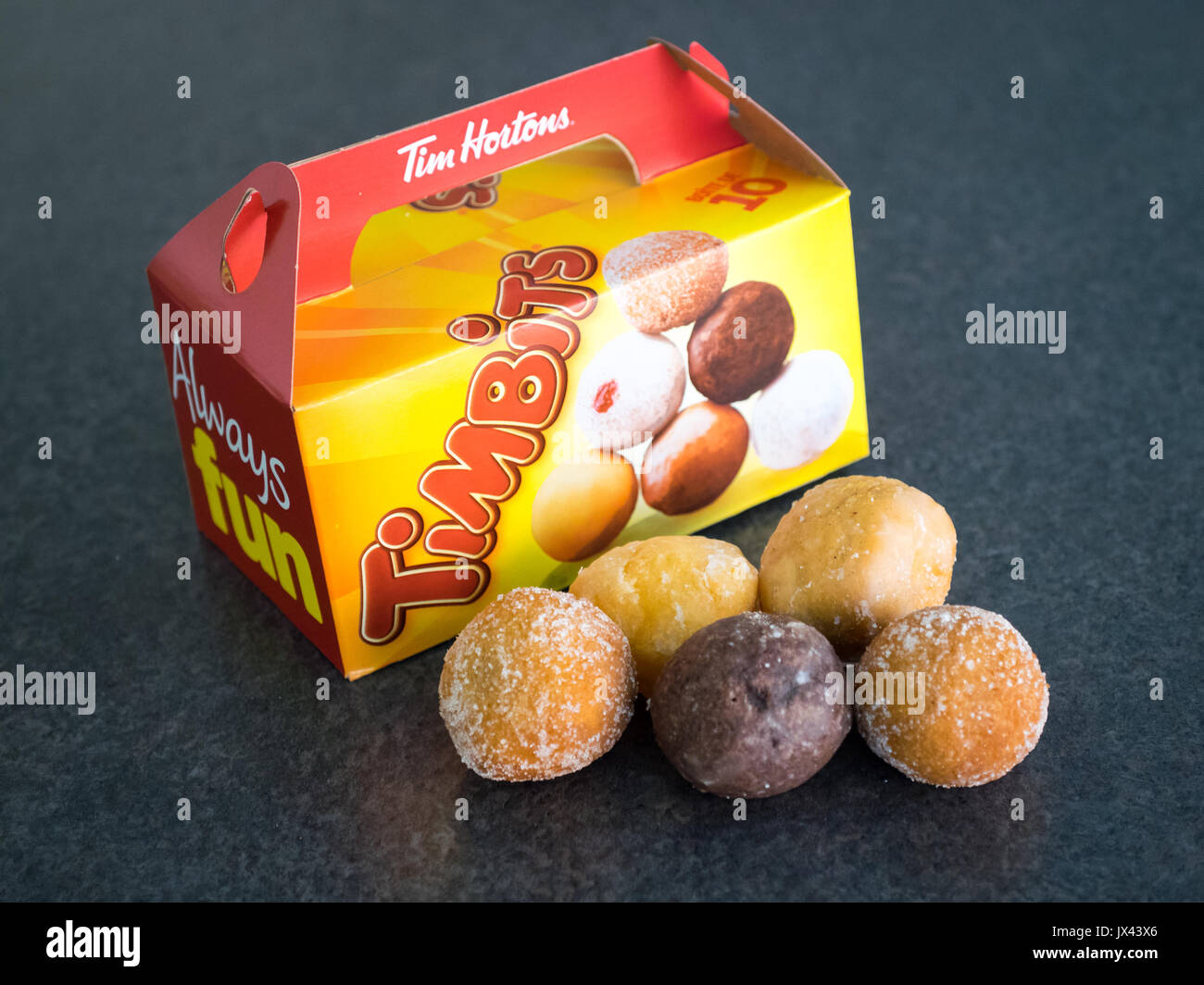 Timbits (donut holes, doughnut holes) from Tim Hortons, a popular Canadian fast food restaurant chain. Stock Photo