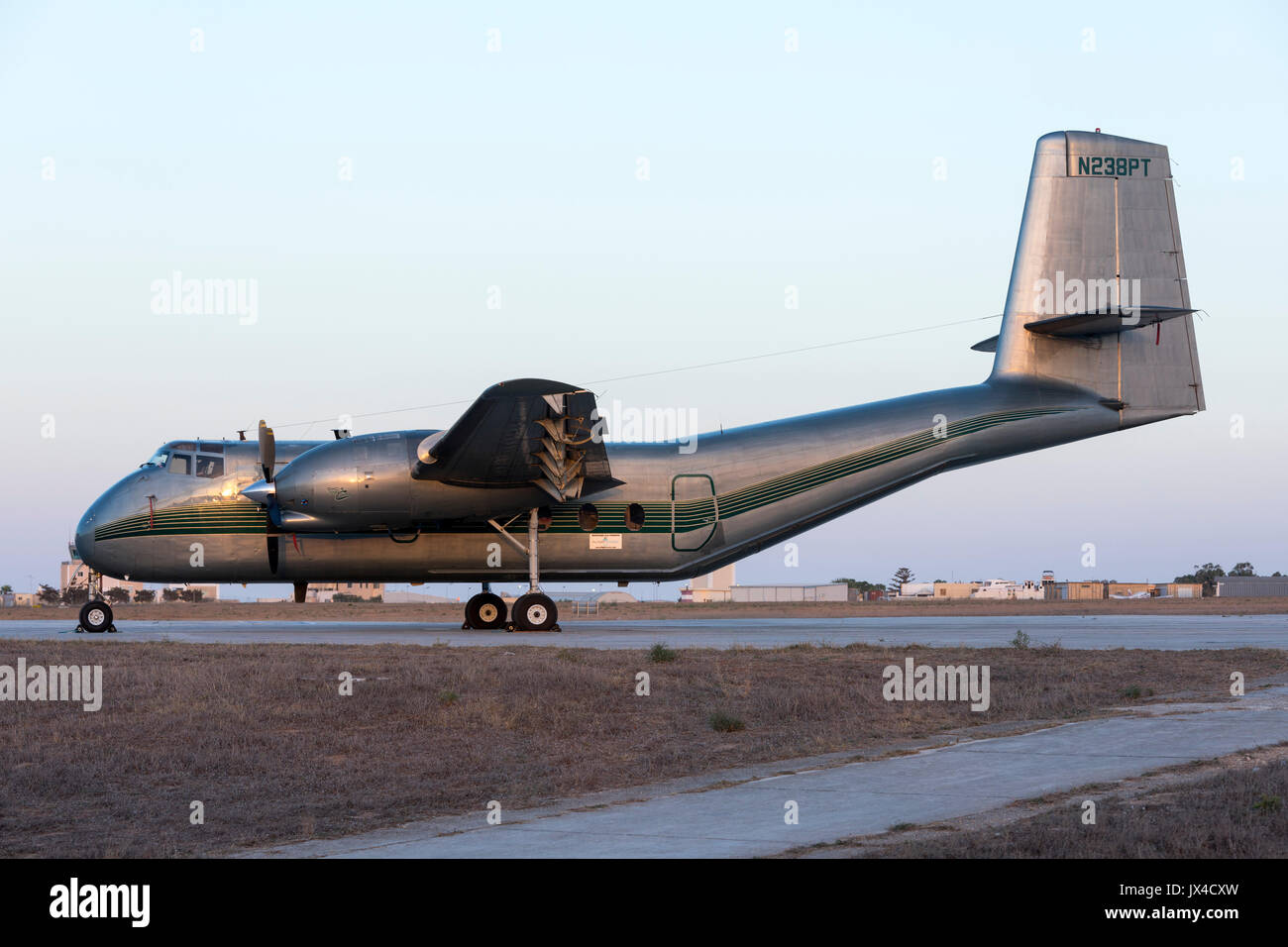 A turboprop converted De Havilland Canada DHC-4 Caribou [Reg.: N238PT] parked in apron 4 in the late evening. - Stock Image