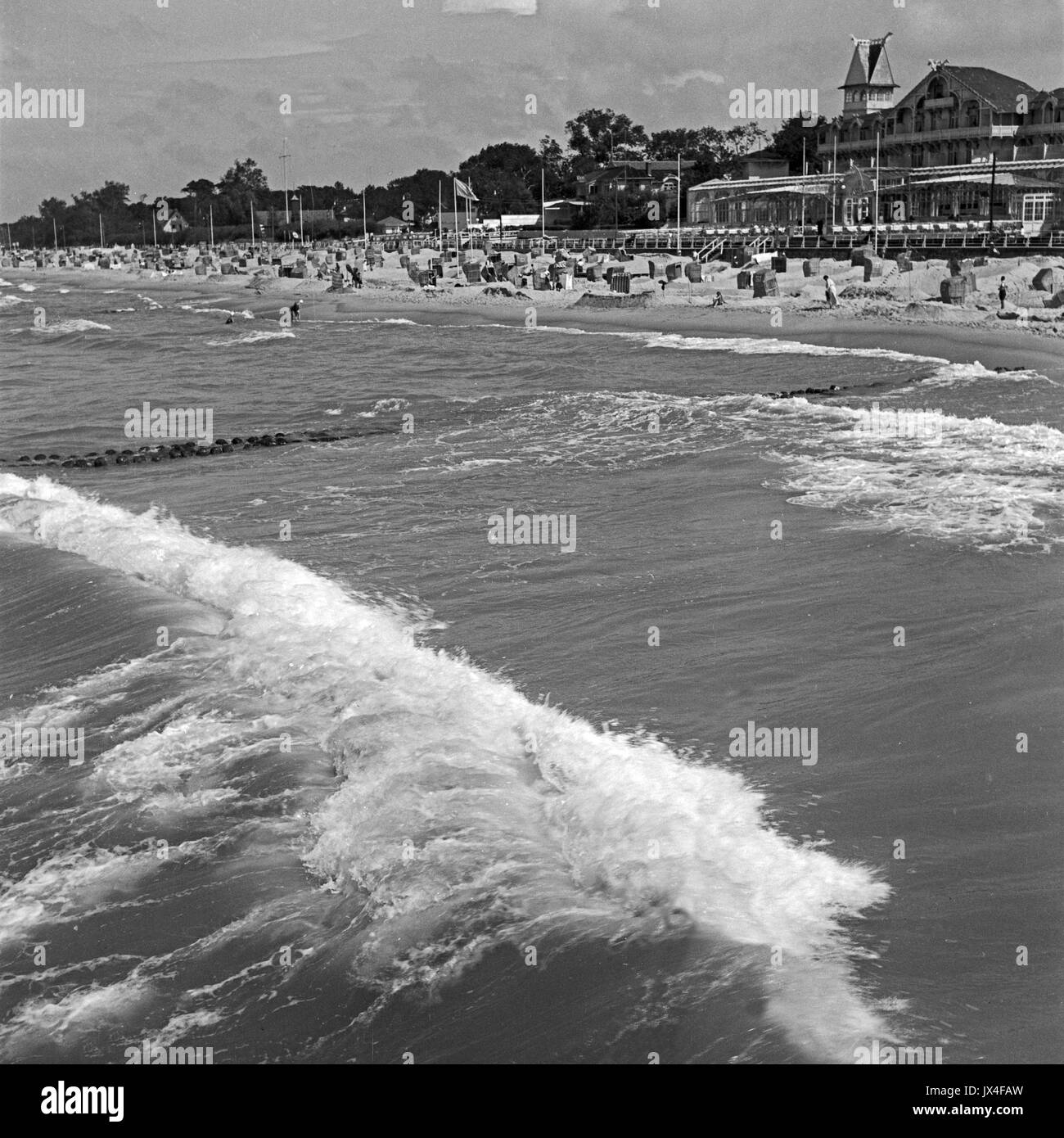 Waves along shoreline at seaside resort. - Stock Image