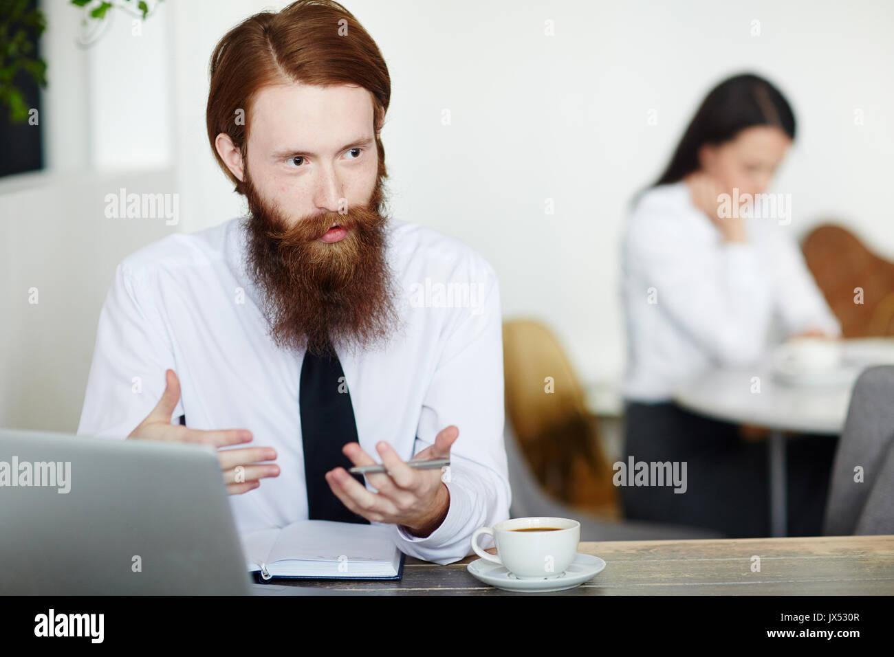 Explaining of businessman - Stock Image