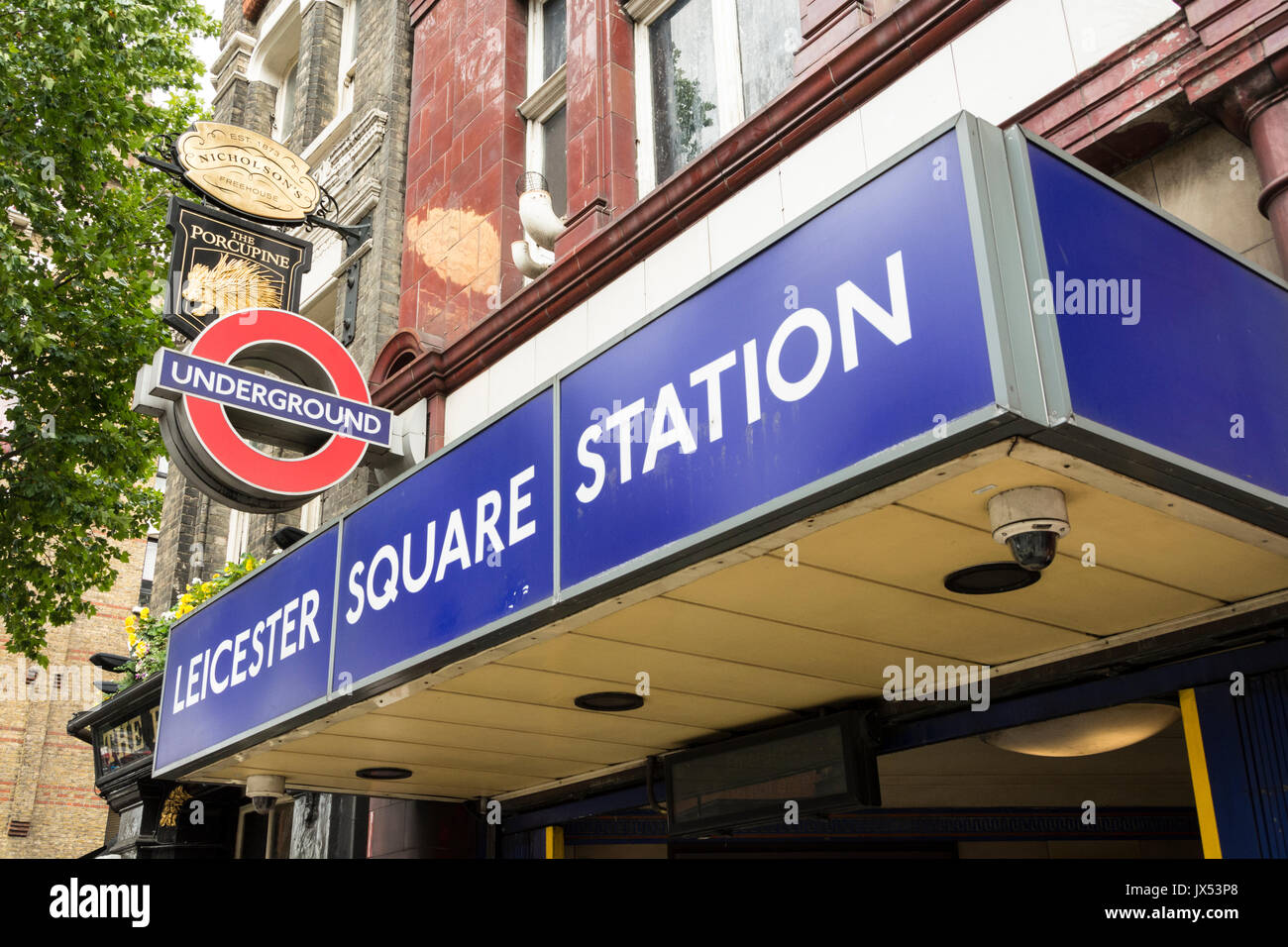Leicester Square tube station entrance in London's West End. - Stock Image