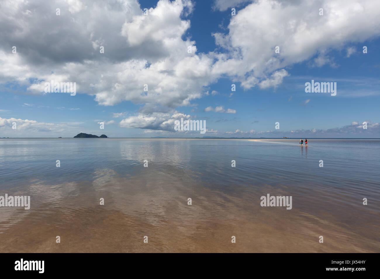 Walking on the water at Hin Kong Beach, Koh Phangan island, Thailand - Stock Image