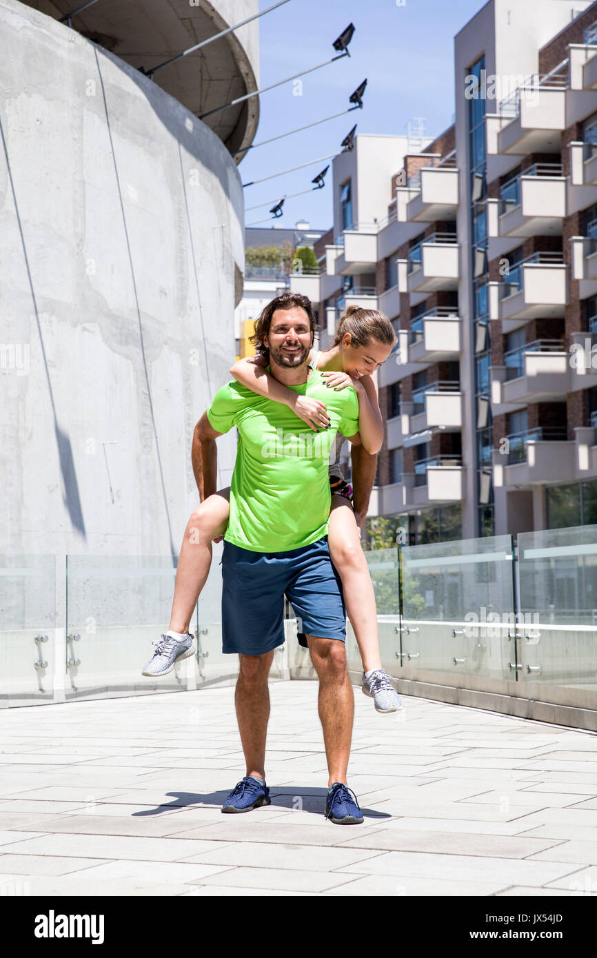 Attractive young couple train in the urban environment Stock Photo