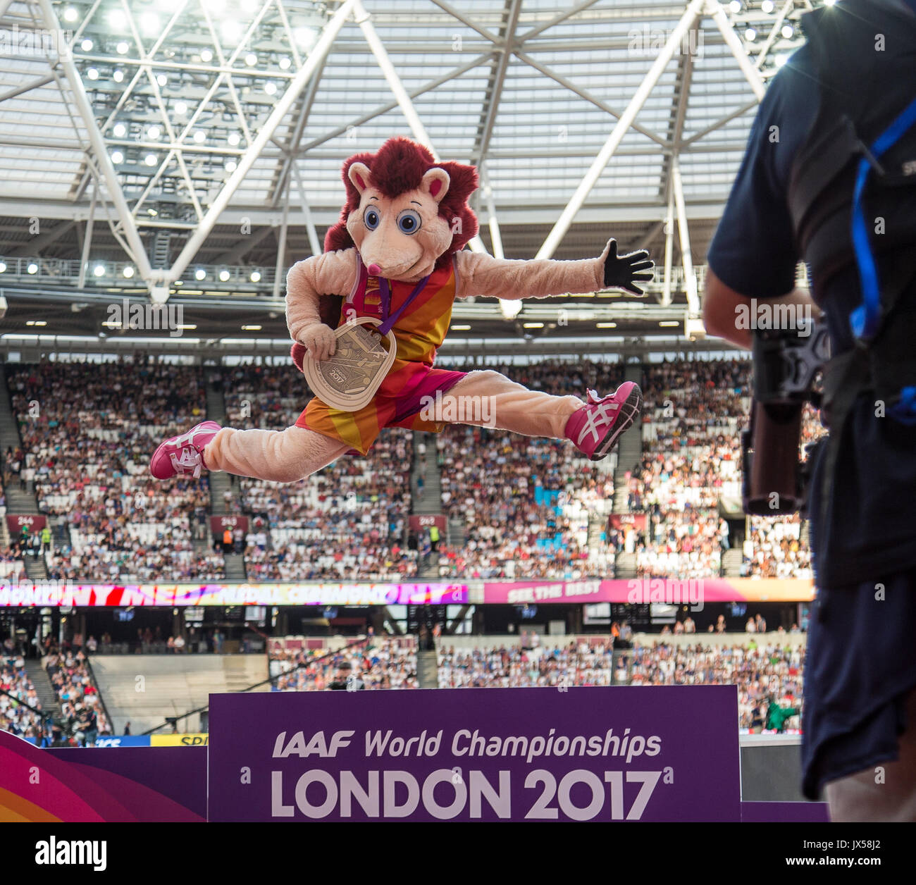 London, UK. 13th Aug, 2017. HERO the Hedgehog mascot celebrates after collecting a Gold Medal as best ever mascot at a World Athletics Games during the Final Day of the IAAF World Athletics Championships (Day 10) at the Olympic Park, London, England on 13 August 2017. Photo by Andy Rowland/PRiME Media Images./Alamy Live News - Stock Image