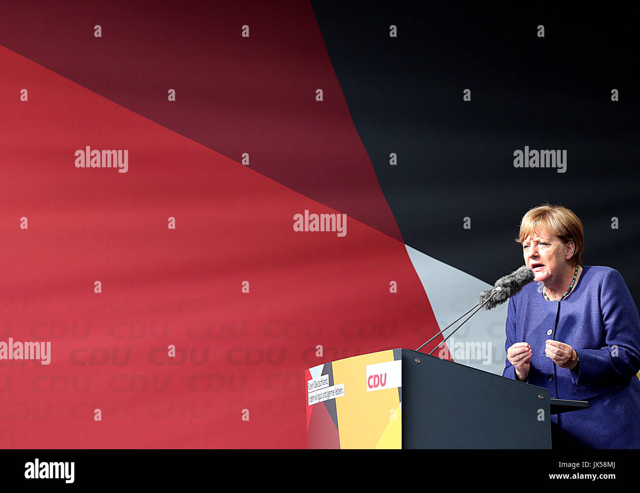 Siegen, Germany. 14th Aug, 2017. German Chancellor Angela Merkel (CDU) speaks during a campaign appearance for the federal parliamentary elections 2017 in Siegen, Germany, 14 August 2017. Photo: Oliver Berg/dpa/Alamy Live News - Stock Image