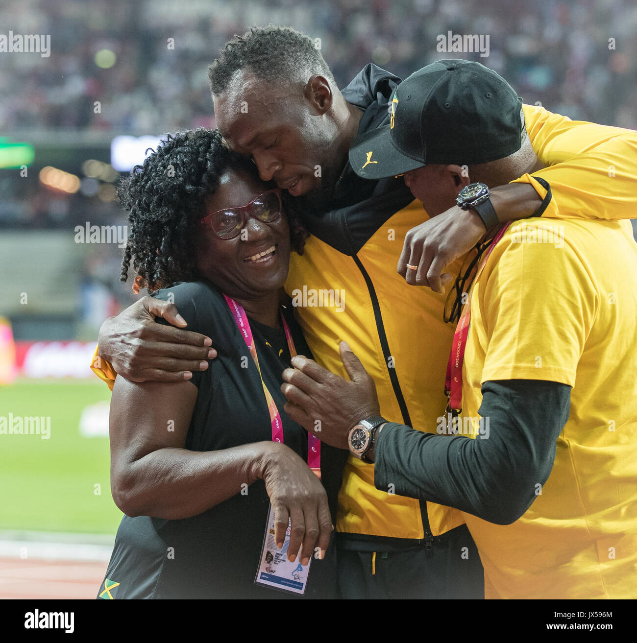 London, UK. 13th Aug, 2017. Usain BOLT with his parents Wellesley and a happy Jennifer Bolt as he bids farewell to the track during the Final Day of the IAAF World Athletics Championships (Day 10) at the Olympic Park, London, England on 13 August 2017. Photo by Andy Rowland/PRiME Media Images. Credit: Andrew Rowland/Alamy Live News - Stock Image