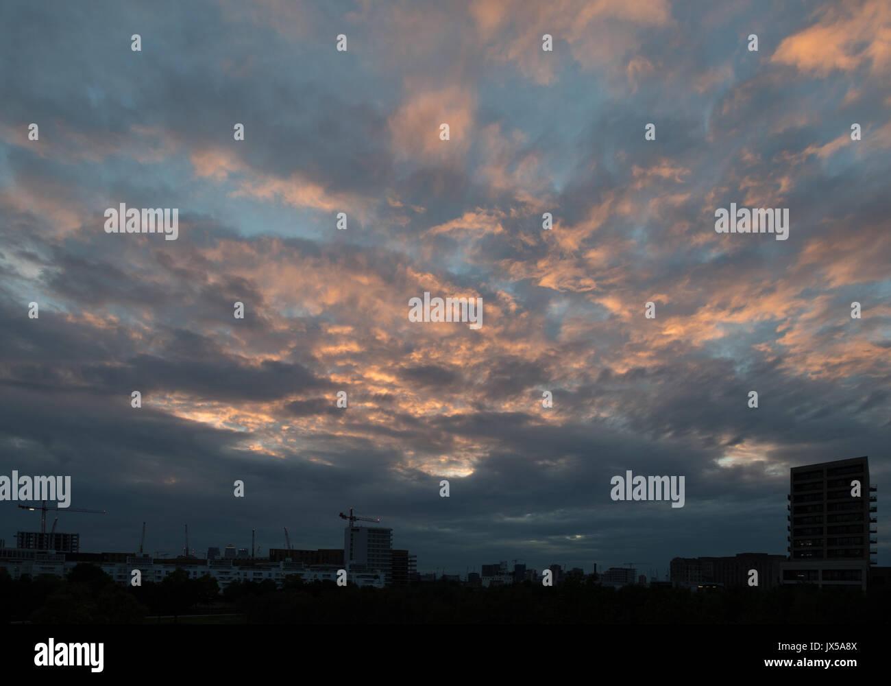 Silvertown, London, UK. 14th August 2017. UK Weather:  Cloudy orange sunset at London city airport. Credit: WansfordPhoto/Alamy Stock Photo