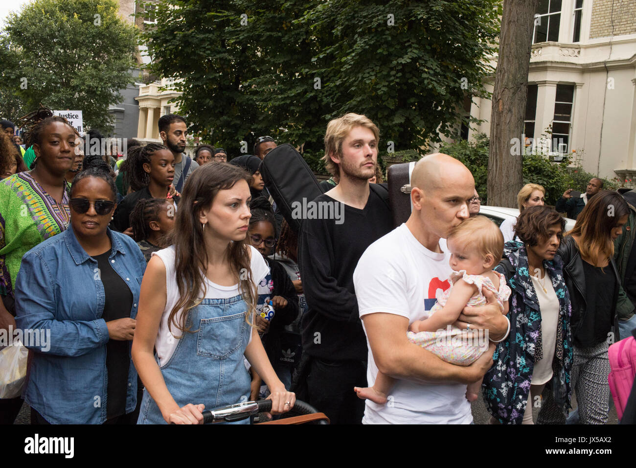 London, UK. 14th August, 2017. Hundreds of people take part in a silent march to demand justice for the victims of the grenfell tragedy that took place in Kensington two months ago. North Kensigton, London, UK 14th August 2017 Credit: Lewis Inman/Alamy Live News - Stock Image