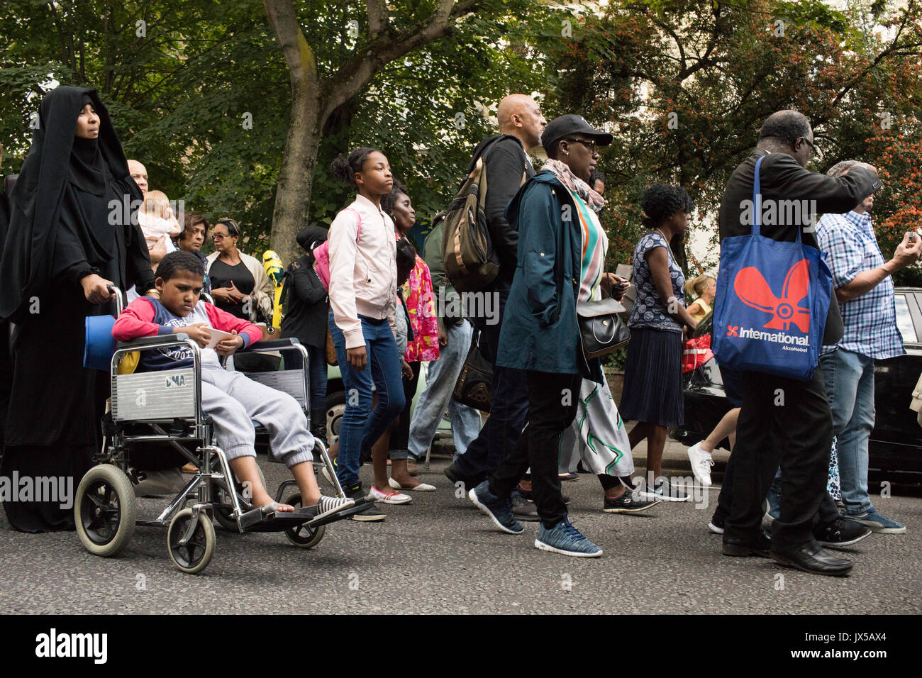 London, UK. 14th August, 2017. Hundreds of people take part in a silent march to demand justice for the victims Stock Photo