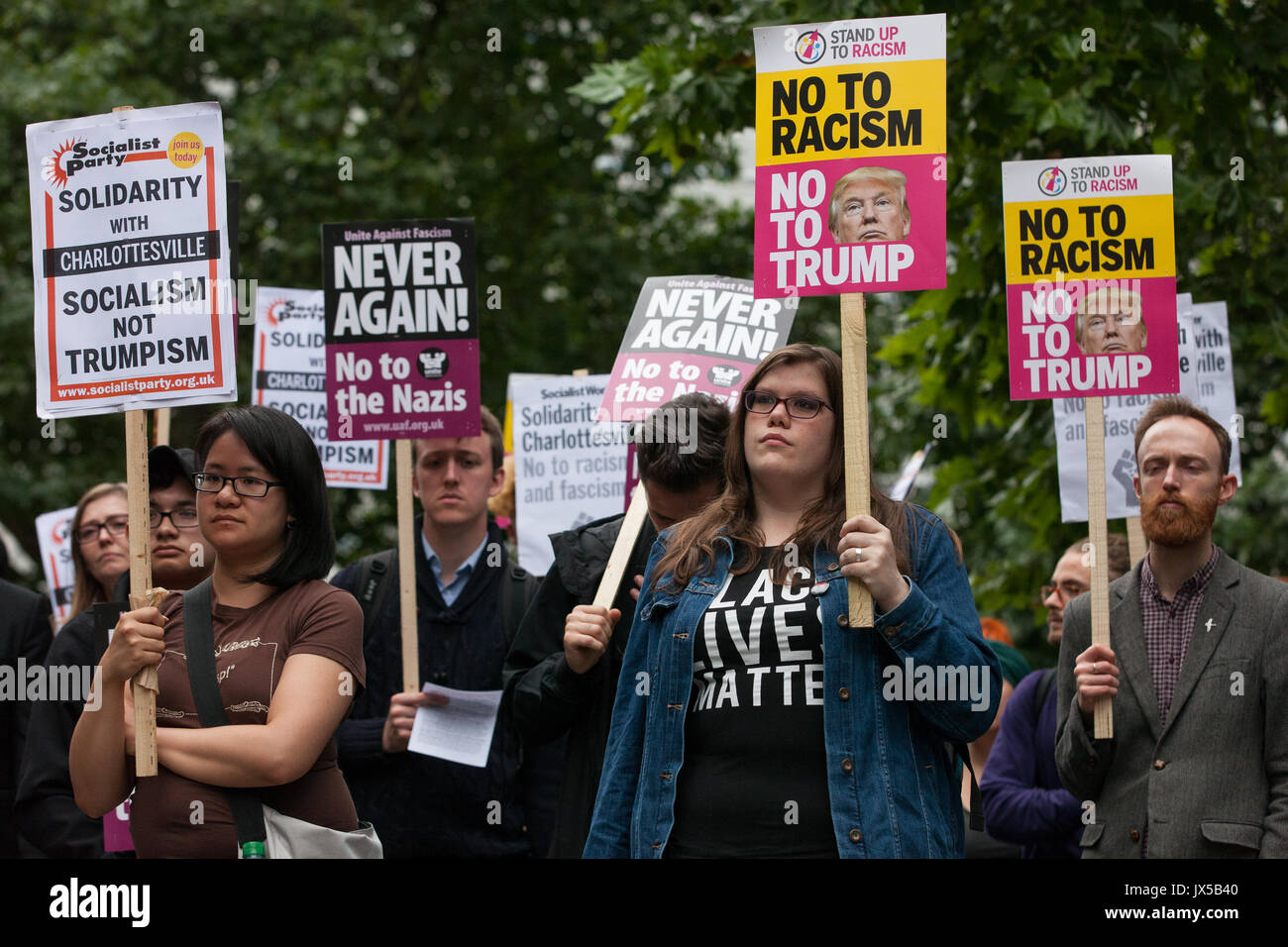 London, UK. 14th August, 2017. Supporters of Unite Against Fascism hold a vigil outside the US embassy in solidarity Stock Photo