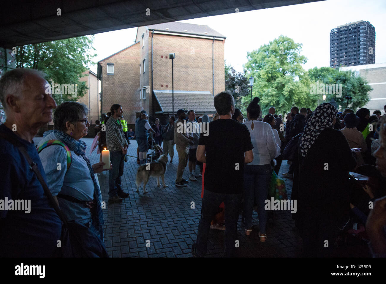 London, UK. 14th August, 2017. Supporters of the Justice for Grenfell campaign hold a rally under the Westway at Stock Photo