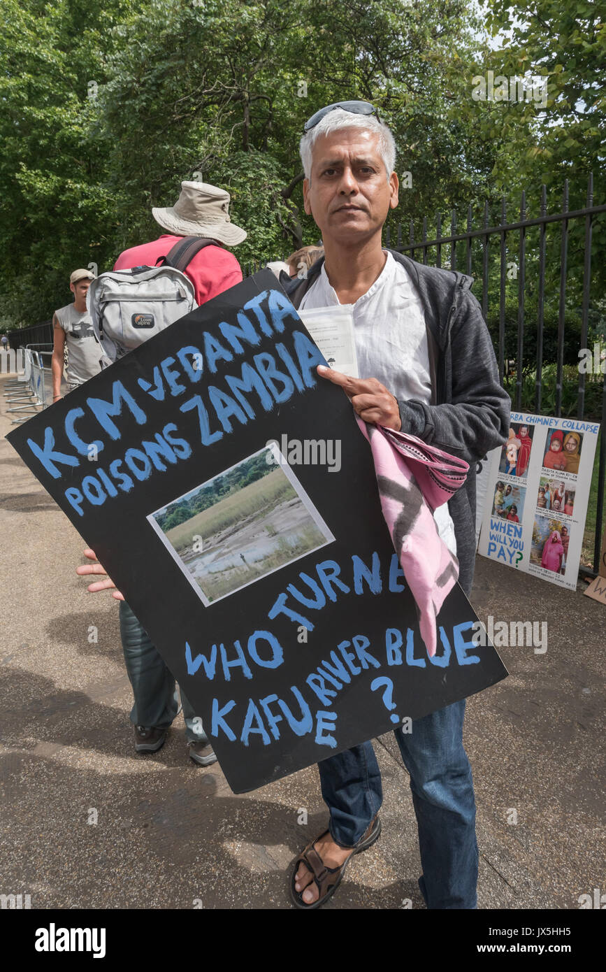 London, UK. 14th Aug, 2017. London, UK. 14th August 2017. Samarendra Das of Grass roots campaign Foil Vedanta holds a poster about pollution of the Kafue River outside the AGM of Vedanta. They accuse Vedanta of illegal mining in Goa, increasing harassment, torture and false accusations against tribal activists in Nyamgiri, Odisha, who have used Indian laws to stop bauxite mining of their sacred mountain, eleven years of ruinous and continuing pollution by Konkola Copper Mines (KCM) in Zambia, where they say the company have fraudulently avoided taxes and failed to publish mandatory accoun - Stock Image