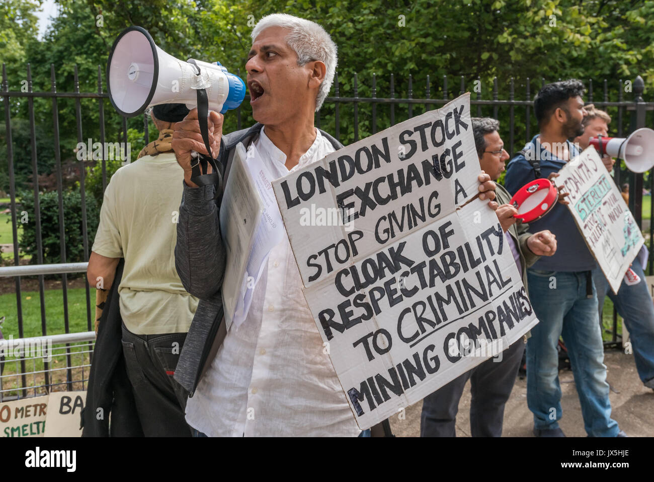 London, UK. 14th Aug, 2017. London, UK. 14th August 2017. Samarendra Das of Grass roots campaign Foil Vedanta holds a poster about calling on the London Stock Exchange to delist the company outside the AGM of Vedanta. They accuse Vedanta of illegal mining in Goa, increasing harassment, torture and false accusations against tribal activists in Nyamgiri, Odisha, who have used Indian laws to stop bauxite mining of their sacred mountain, eleven years of ruinous and continuing pollution by Konkola Copper Mines (KCM) in Zambia, where they say the company have fraudulently avoided taxes and fail - Stock Image