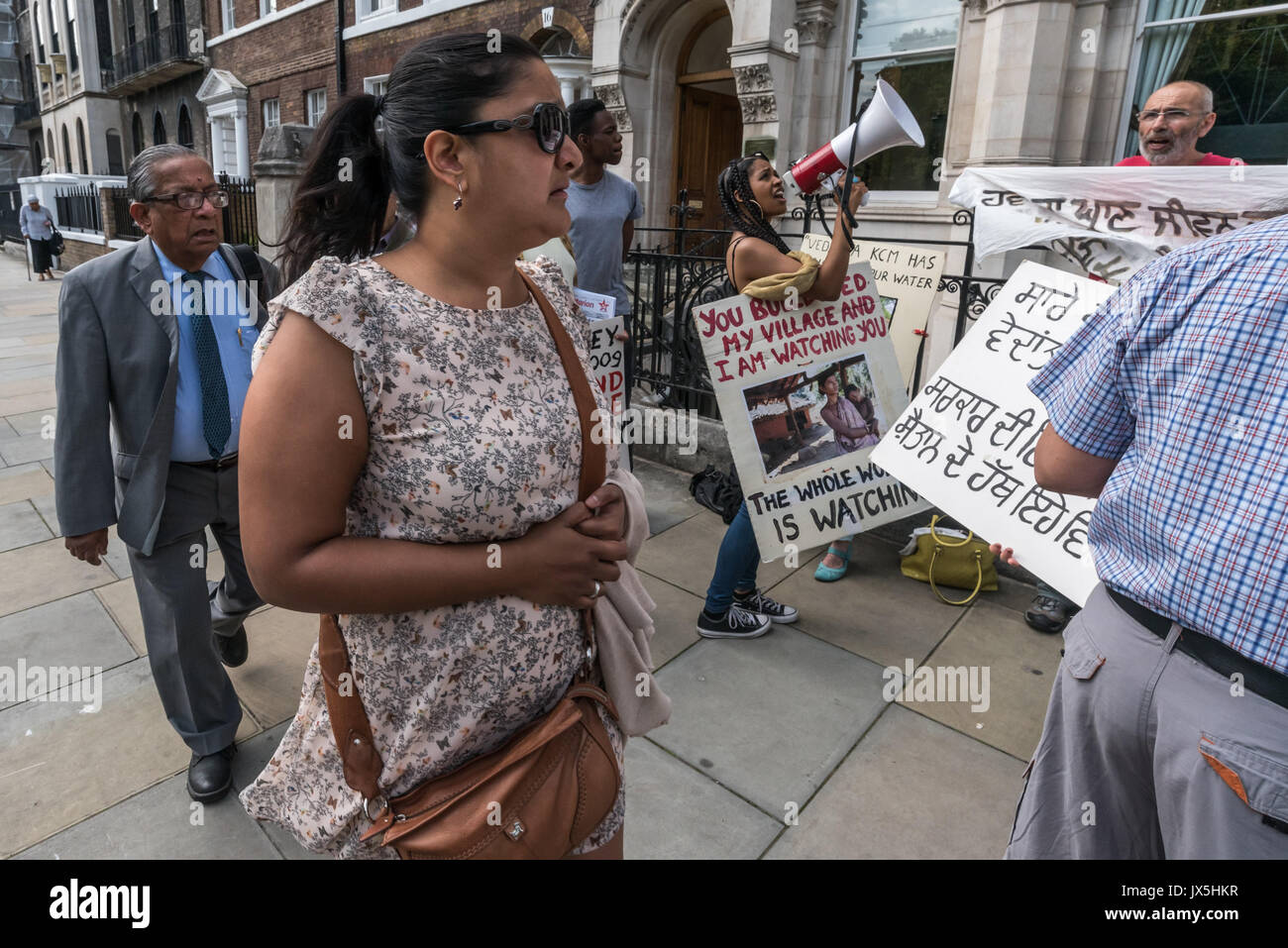London, UK. 14th Aug, 2017. London, UK. 14th August 2017. People attending the Vedanta AGM walk past the noisy protest by grass roots campaign Foil Vedanta. The protesters accuse Vedanta of illegal mining in Goa, of increasing harassment, torture and false accusations against tribal activists in Nyamgiri, Odisha, who have used Indian laws to stop bauxite mining of their sacred mountain, eleven years of ruinous and continuing pollution by Konkola Copper Mines (KCM) in Zambia, where they say the company have fraudulently avoided taxes and failed to publish mandatory accounts and other offen - Stock Image