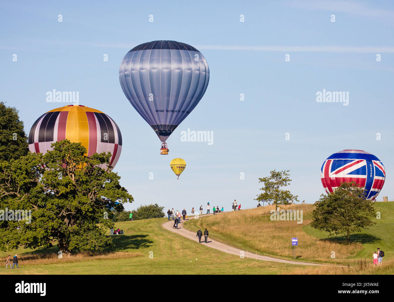 Hot air balloons landing at Ashton Court Somerset after mass ascent from the launch site during the 2017 Bristol Balloon Fiesta Stock Photo