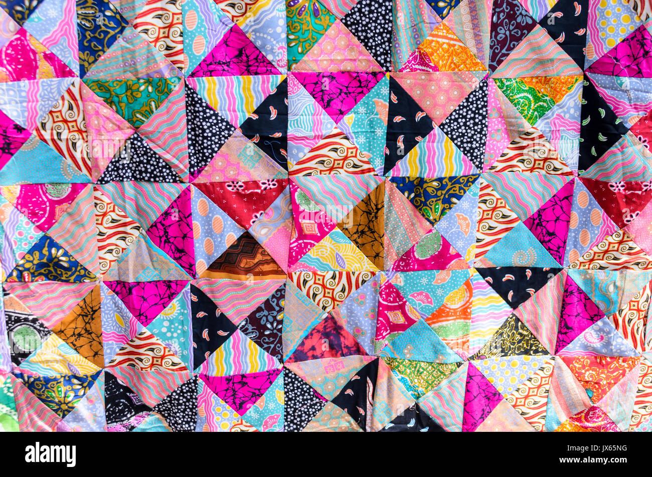 Patchwork quilt on display at the Ubud Art Market, Ubud, Bali - Stock Image