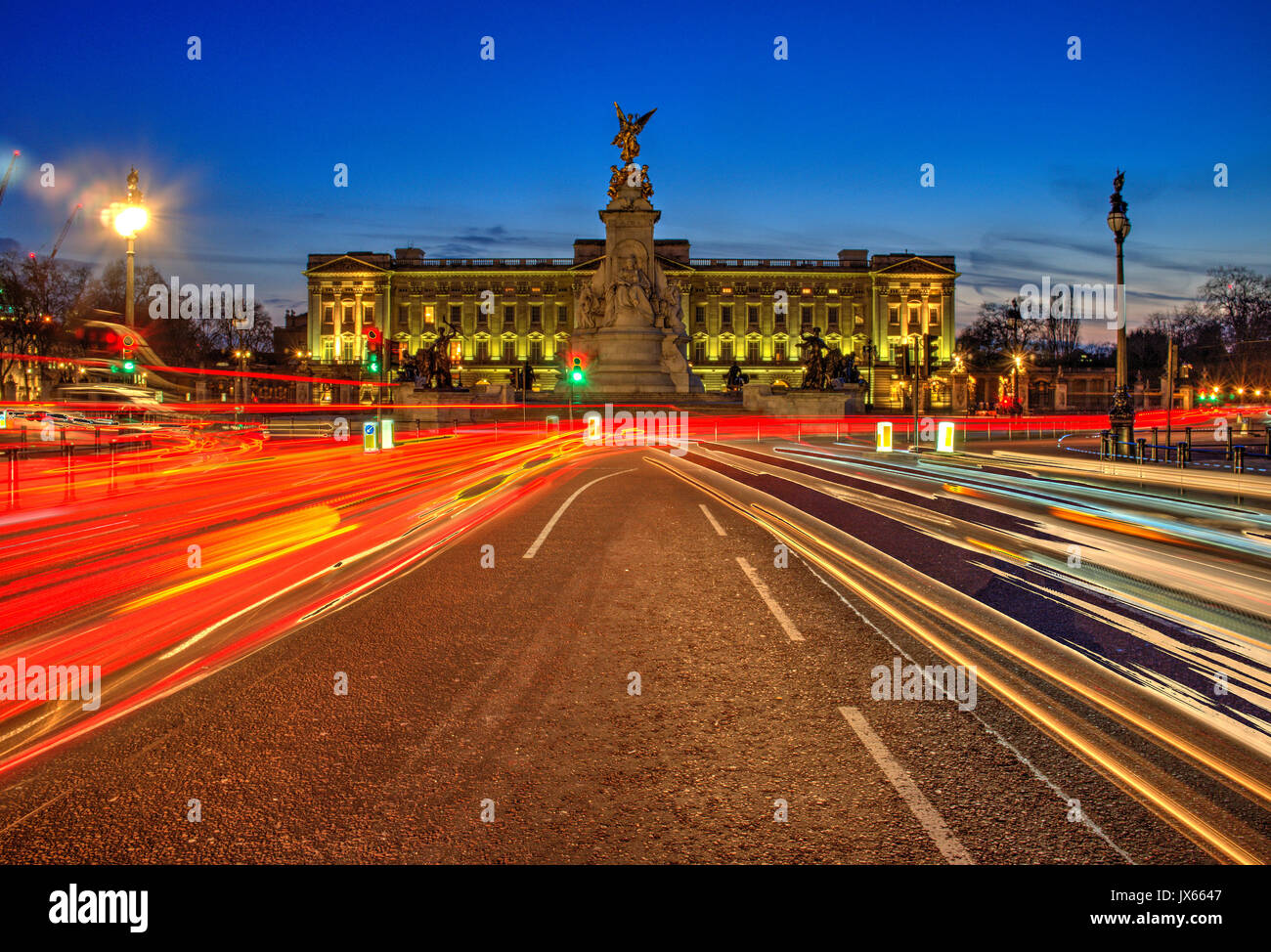 Buckingham palace London at night with traffic trails - Stock Image