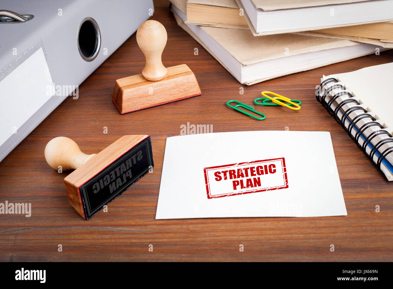 Strategic Plan. Rubber Stamp on desk in the Office. - Stock Image