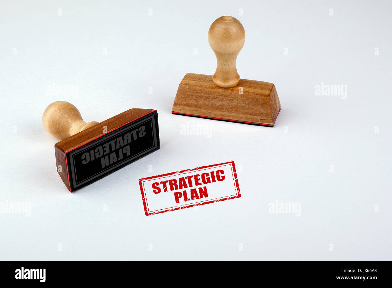 Strategic Plan. Rubber Stamper with Wooden handle Isolated on White Background. - Stock Image