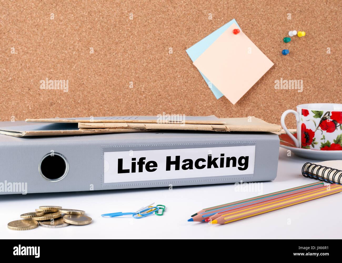 Life Hacking. Folder on office desk. Money, Coffee Mug and colored pencils. - Stock Image
