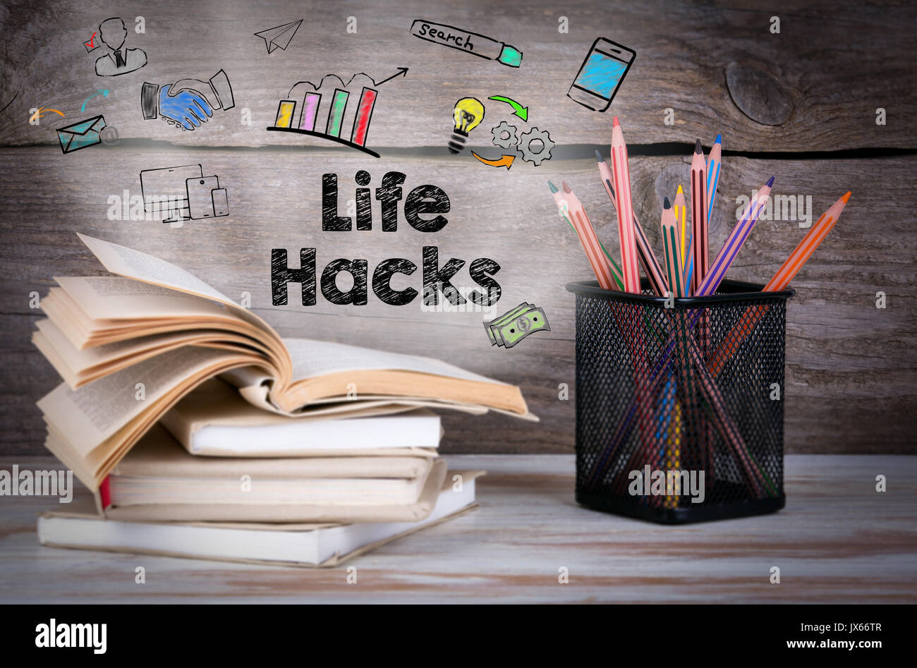 Life Hacks. Stack of books and pencils on the wooden table. - Stock Image