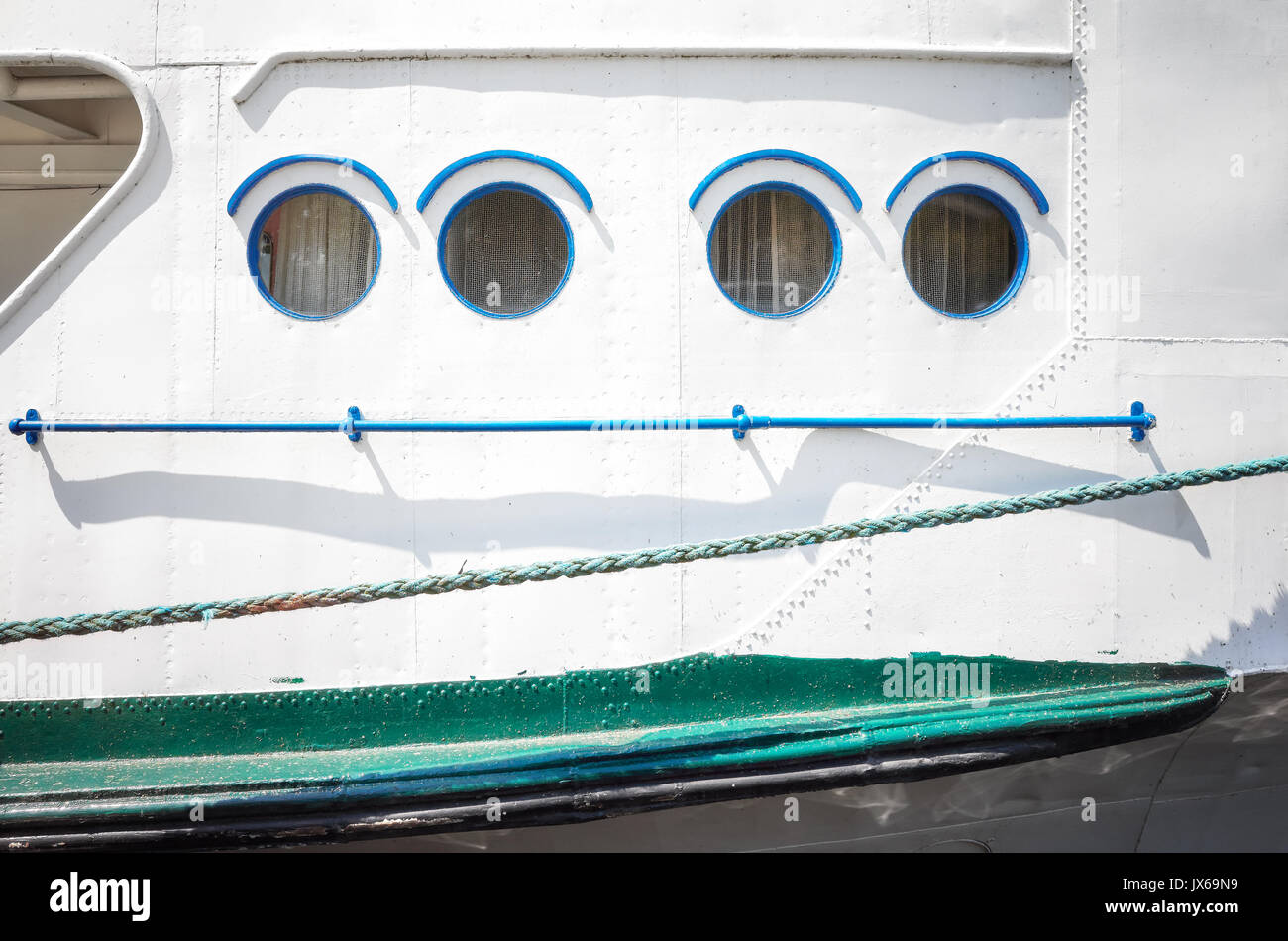 Close up picture of an old ship side and portholes. - Stock Image