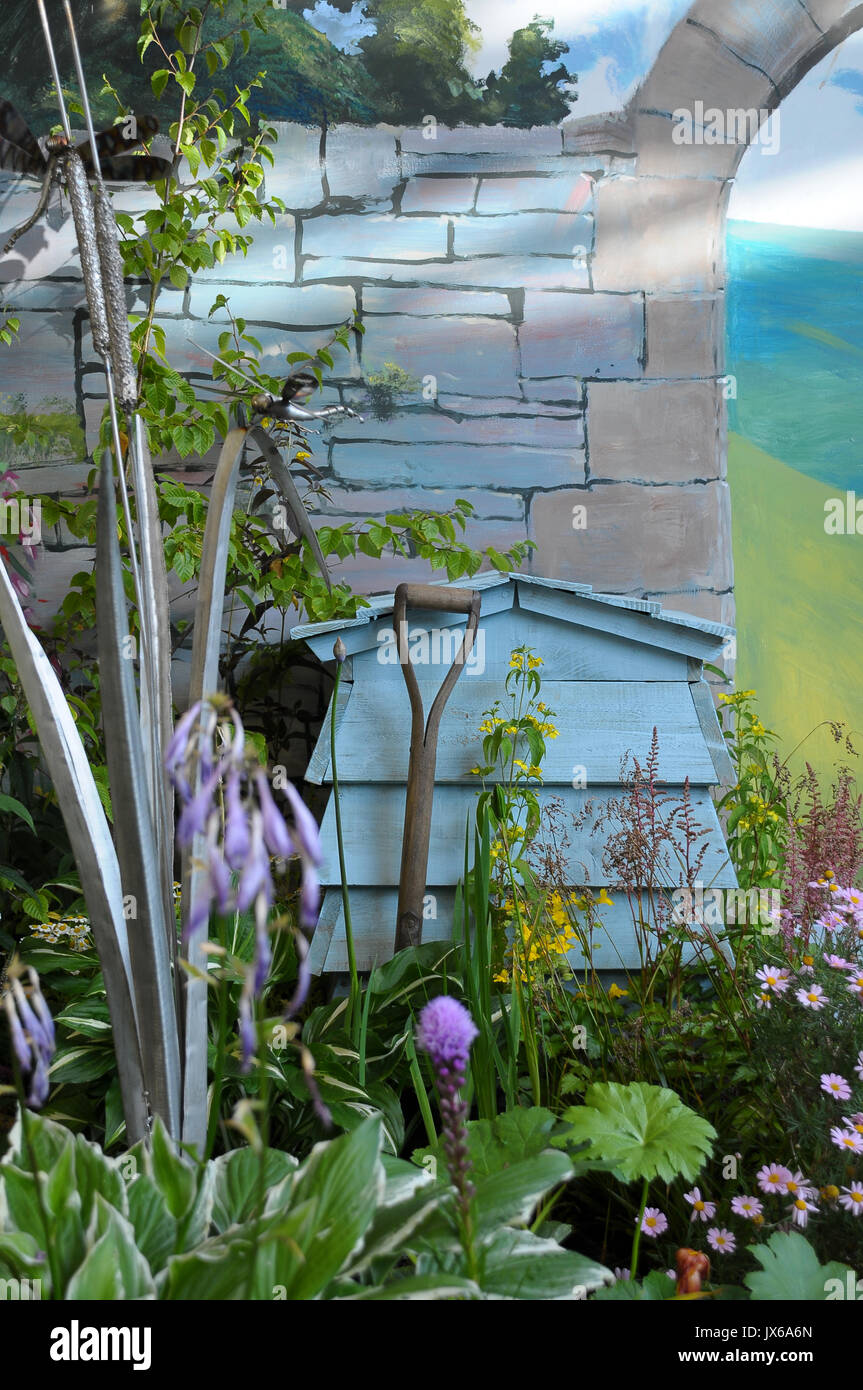 a beautiful country garden with bee hive and flowers - Stock Image