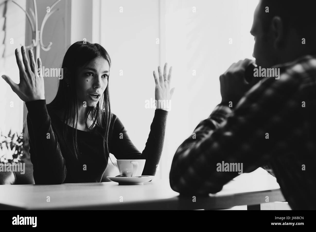 Young couple arguing in a cafe. Relationship problems. - Stock Image
