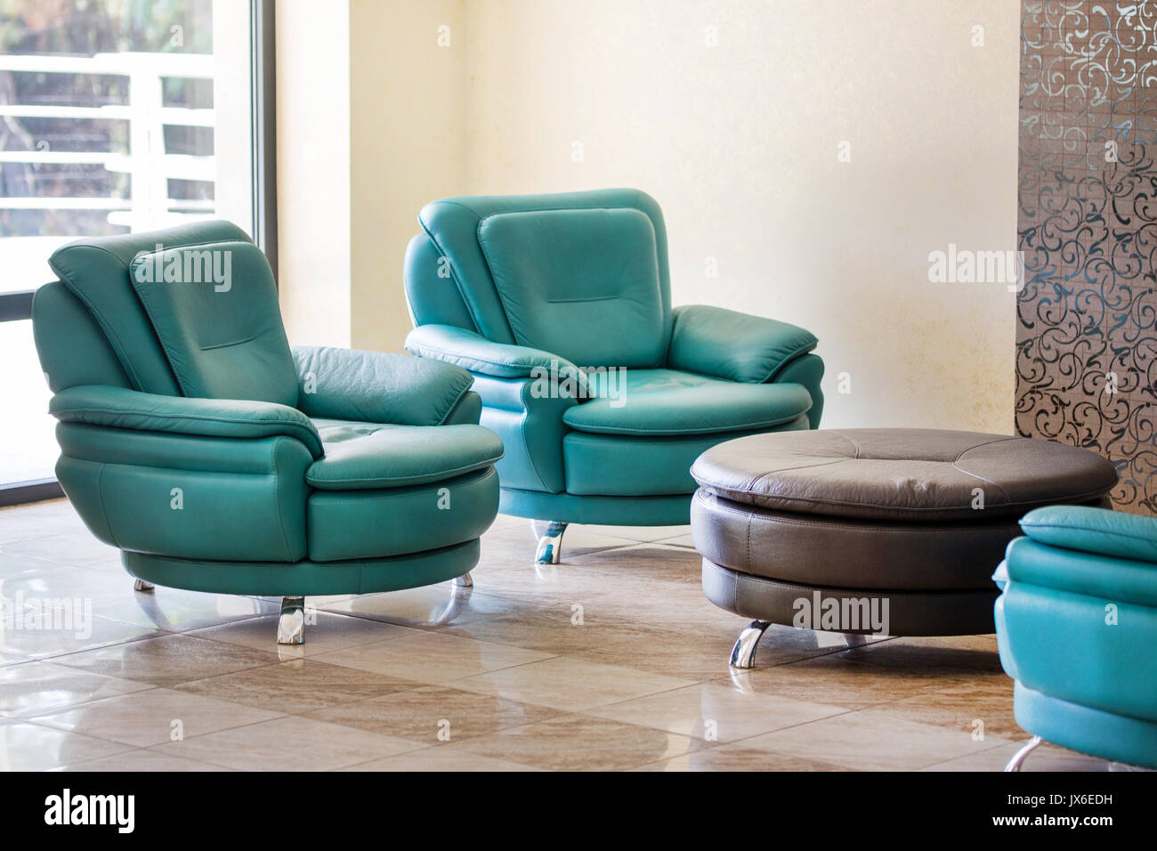 fortable modern luxury leather armchairs and round table in a hall JX6EDH