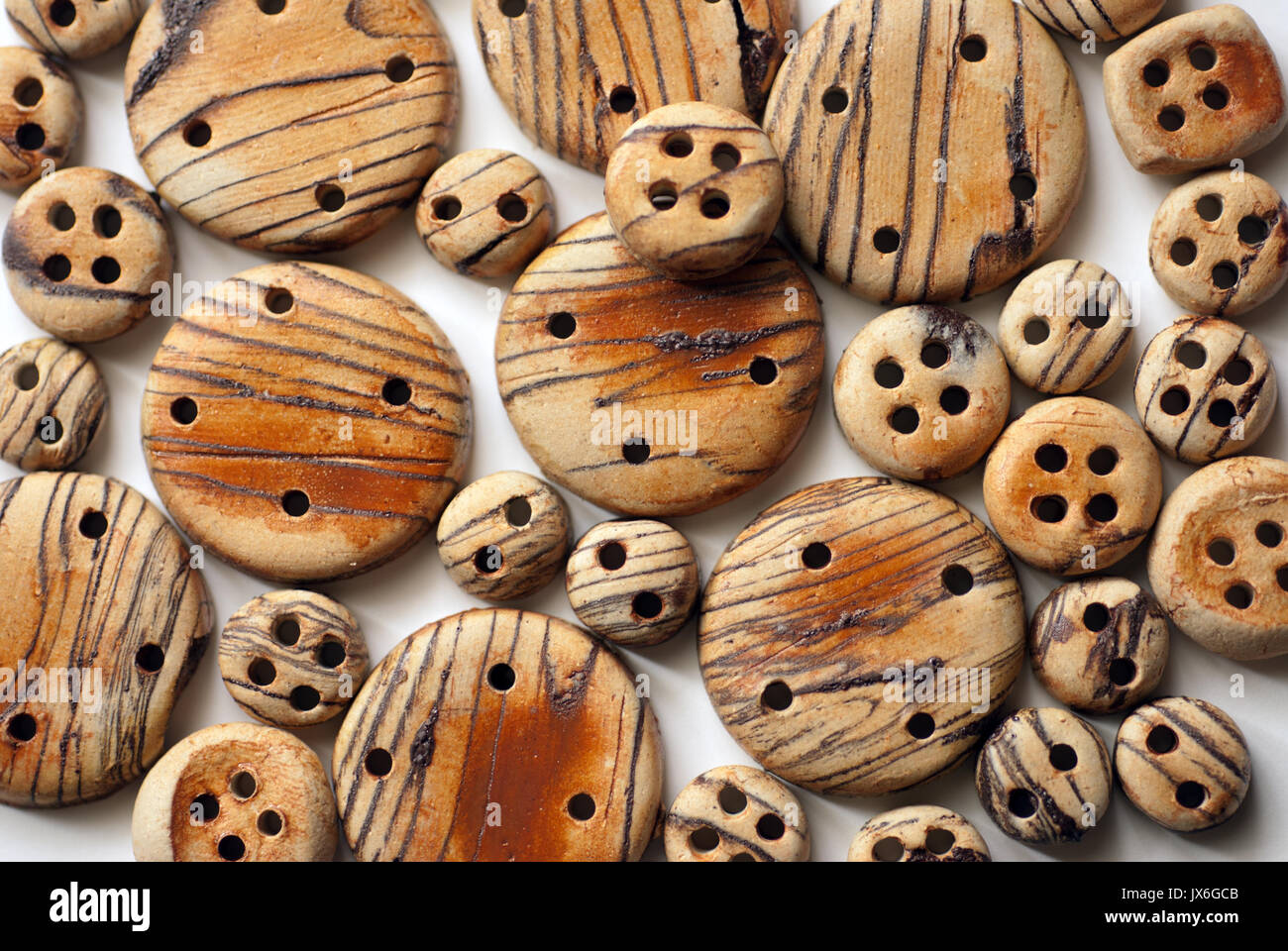 Ceramic buttons with faux woodgrain - Stock Image