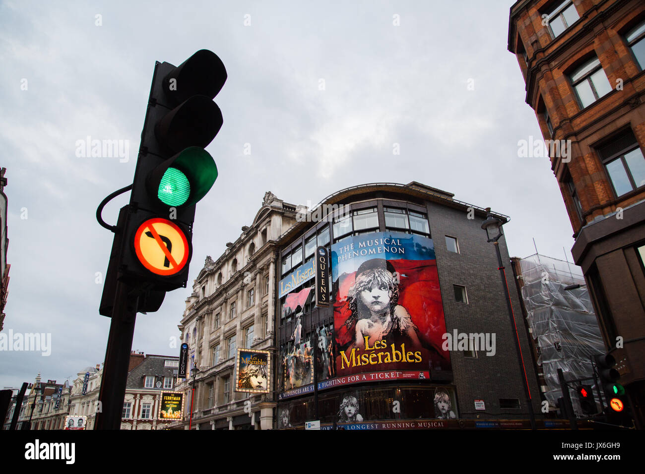 Les Miserables Display on show at The Queens Theatre, Shaftesbury Avenue, London UK with Traffic Light at Green in Landscape Orientation. - Stock Image