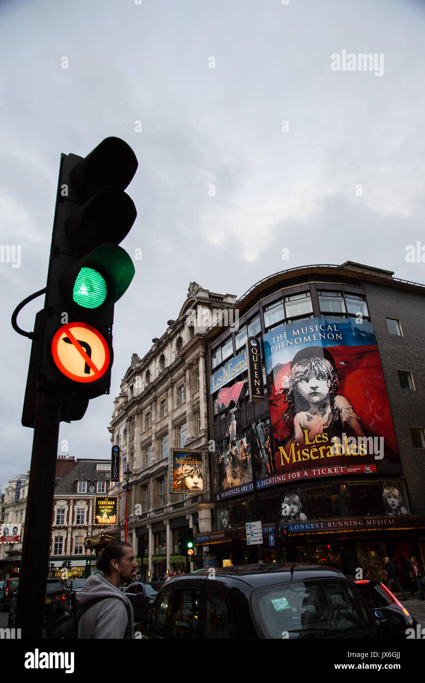 Les Miserables Display on show at The Queens Theatre, Shaftesbury Avenue, London UK with Traffic Light at Green in Portrait Orientation. - Stock Image