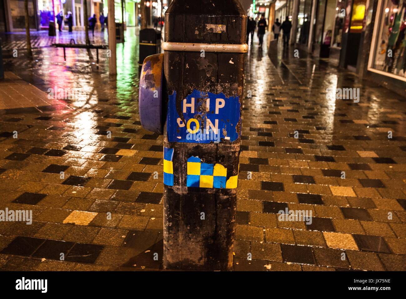 Partially ripped safety sign on lamp post in central Glasgow. - Stock Image