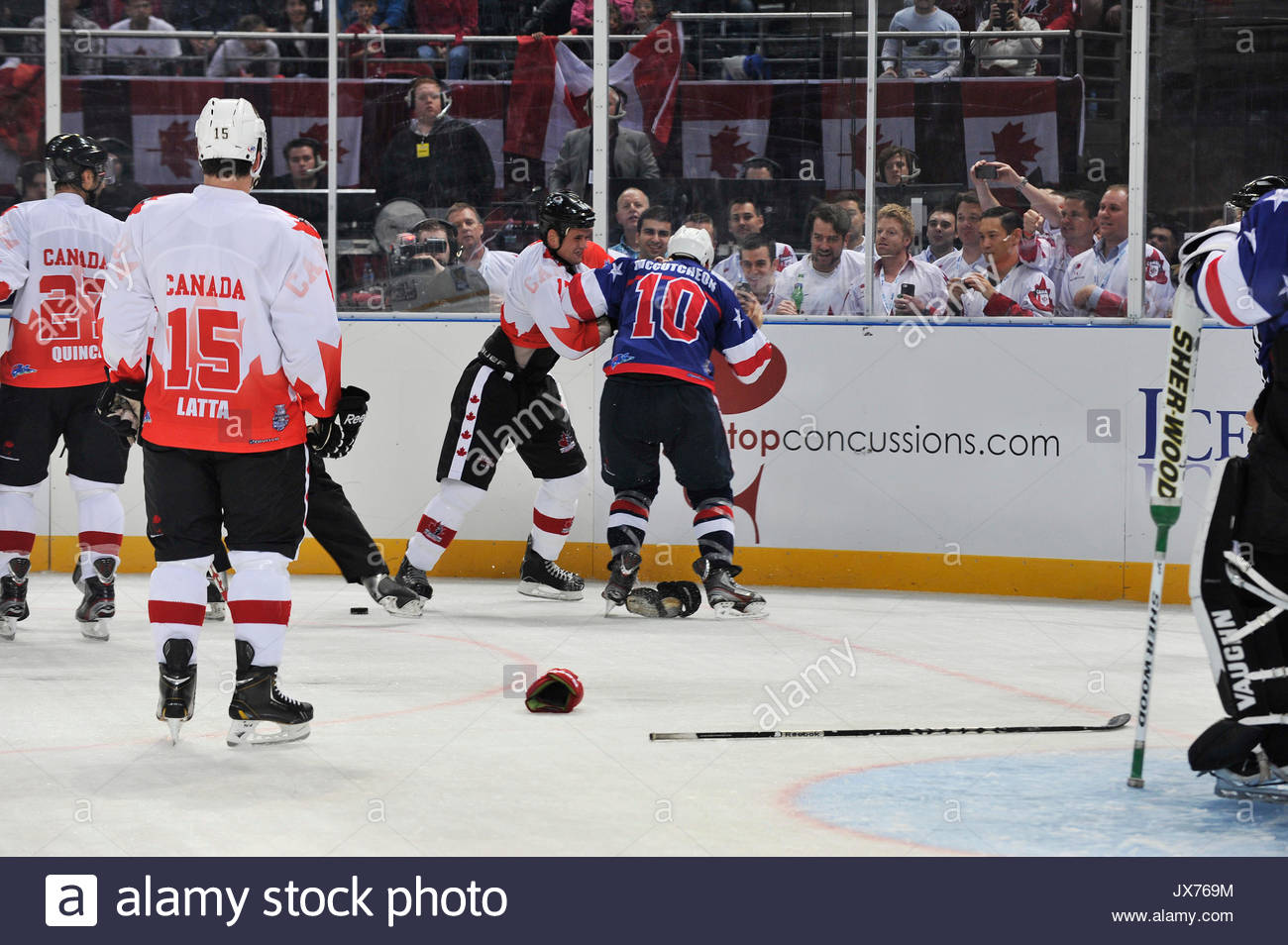 745b39871c5 Kevin Harvey of Team Canada wrestles with Mark McCutcheon of Team USA.  Leading ice hockey players compete in the IIHT International Ice Hockey  Tournament to ...