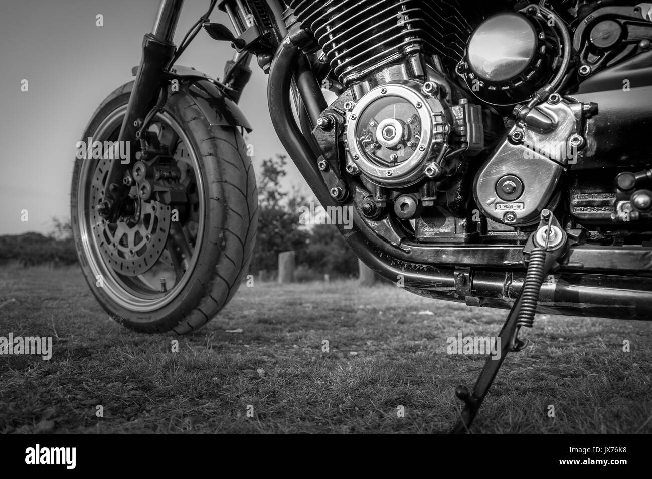 A close up shot of a custom made motorbike in black and white - Stock Image