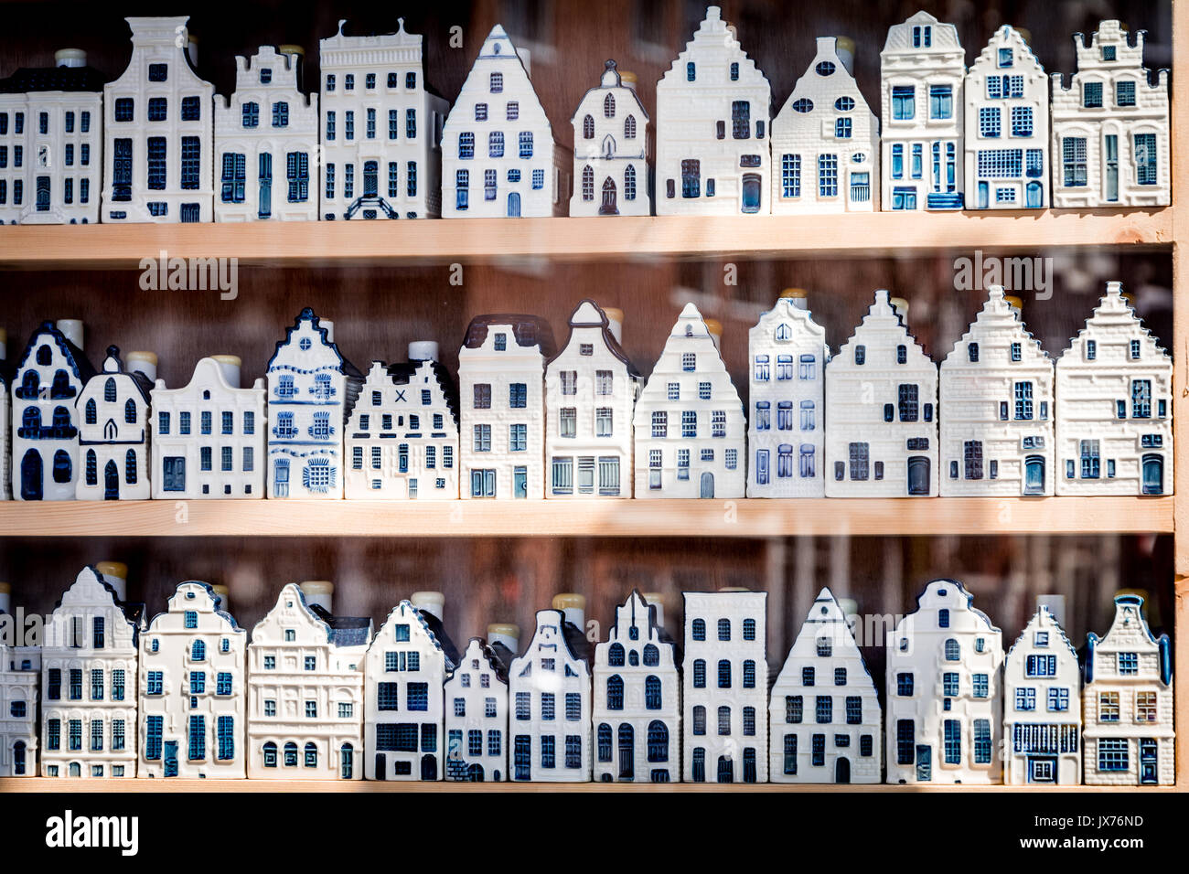 Shop window with 3 rows of Delftware porcelain Dutch style houses - Stock Image