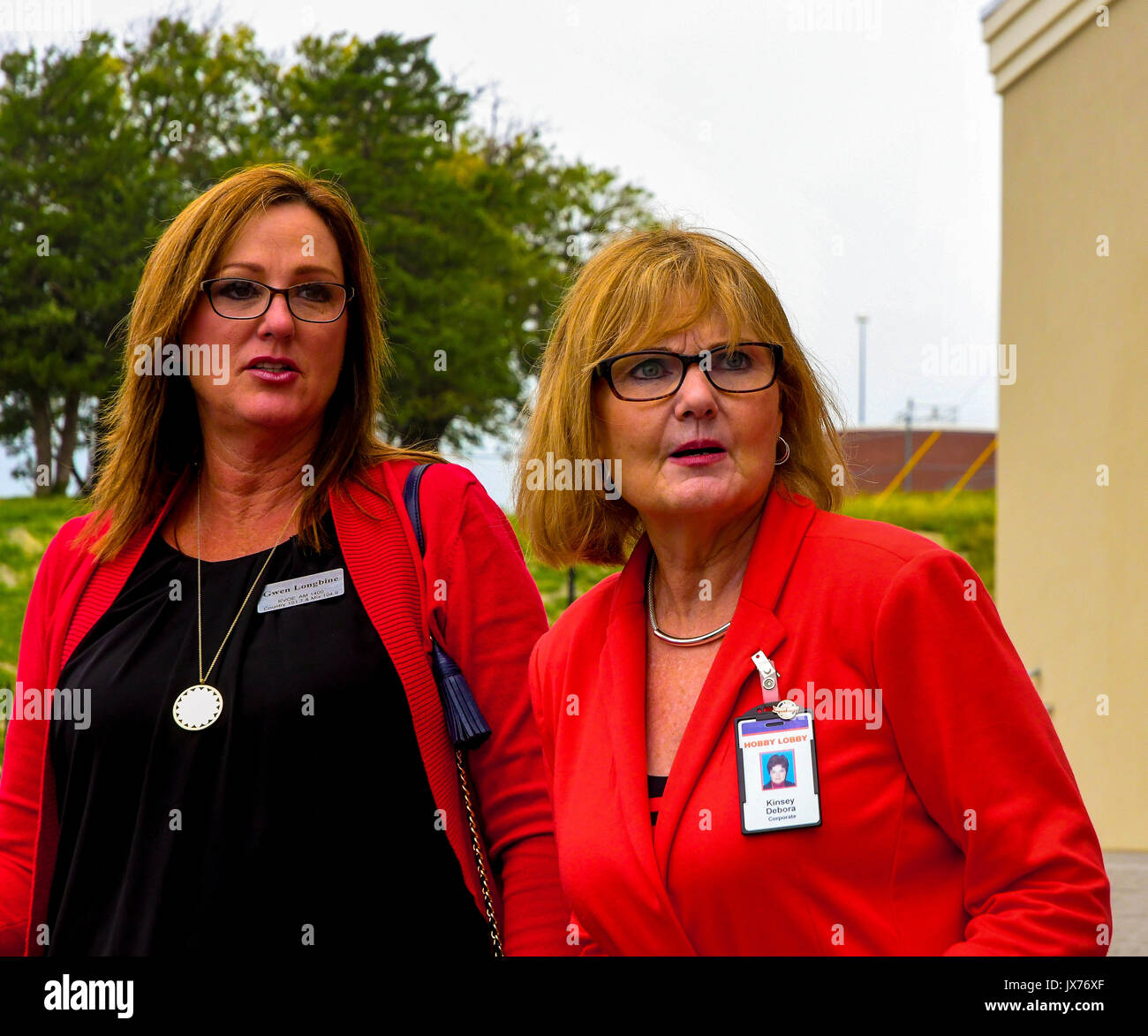 Gwen Longbine (L) of Emporia radio station KVOE (and wife of Kansas State senate  Vice President Jeff Longbine) and Debora Kinsey a corporate representive of Hobby Lobby at the grand opening of the newest store today in Emporia, Kansas August 13. 2017. - Stock Image