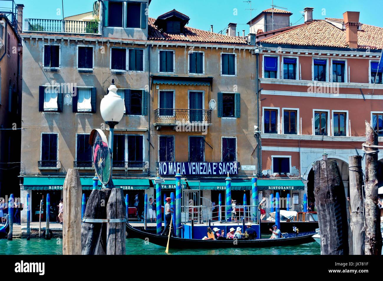 "Grand Canal. Banner reading ""No Mafia Venice is sacred"". Pillars. UNESCO world heritage site. Venice, Veneto, Italy, Europe - Stock Image"