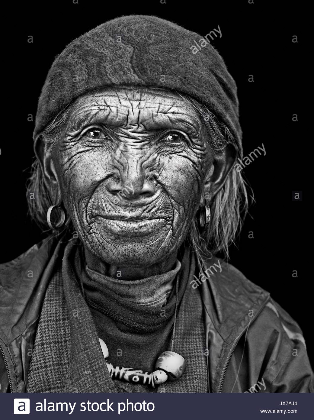 Portrait of a Loba man from the border of Mustang, Nepal and Tibet. - Stock Image