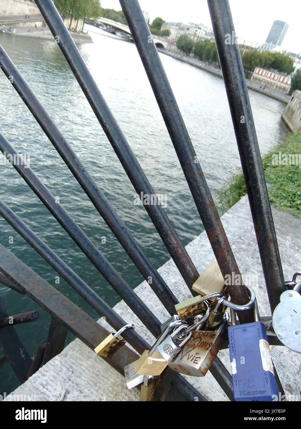 Love Locks on the Pont des Arts in Paris - Stock Image