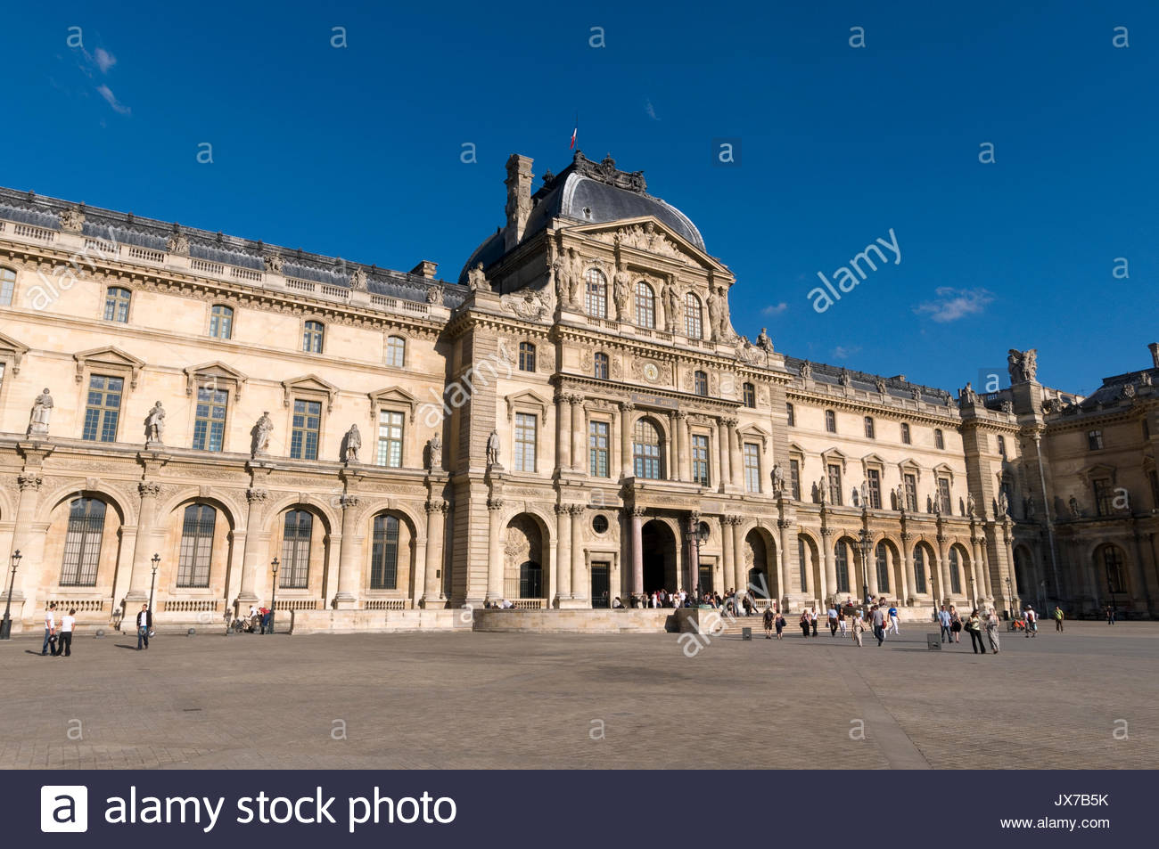 The main court of The Louvre museum. - Stock Image