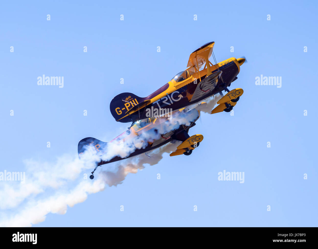 Trig Aerobatic Team performing close-formation aerobatic stunts in their Pitts Special S-1D biplanes - Stock Image