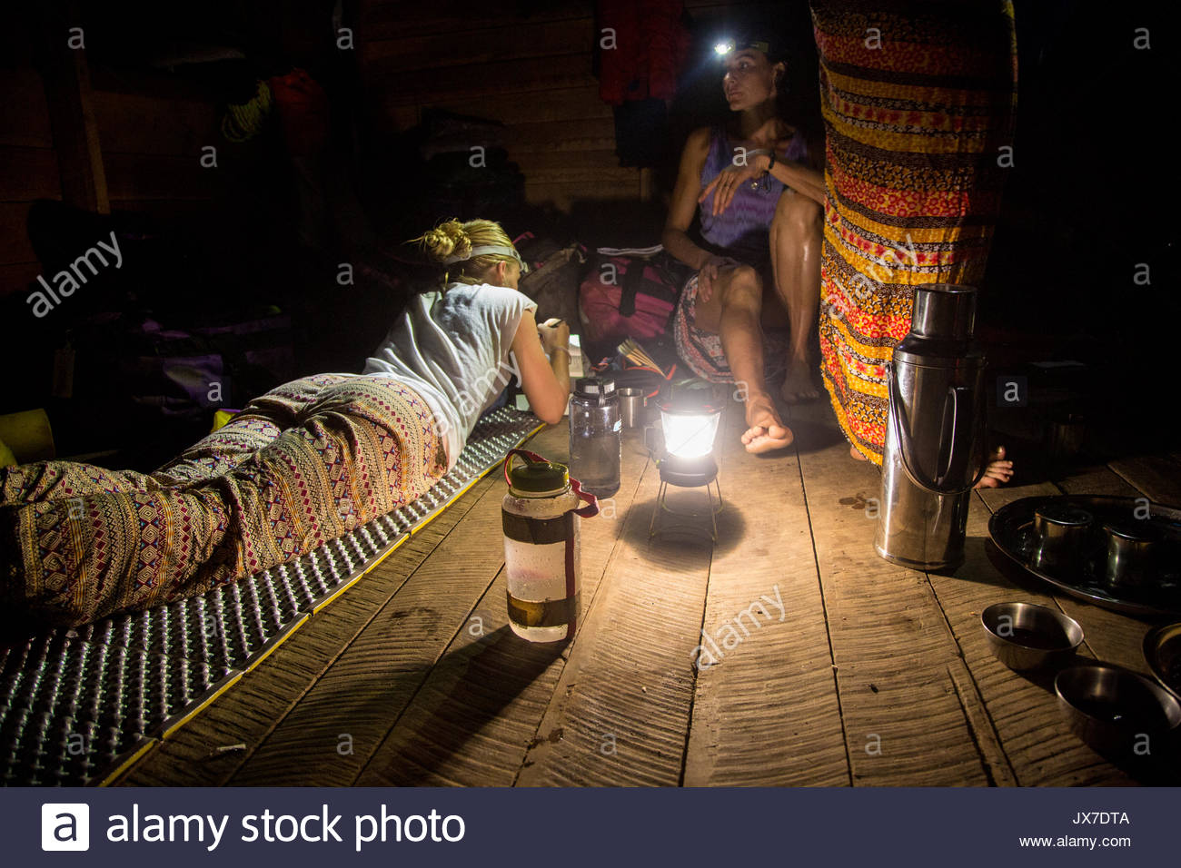 Expedition members resting inside of a wooden building. - Stock Image