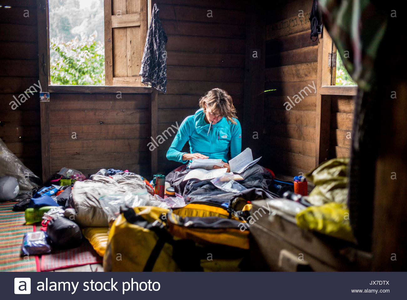 The expedition leader reviews documents and plans for the team. - Stock Image