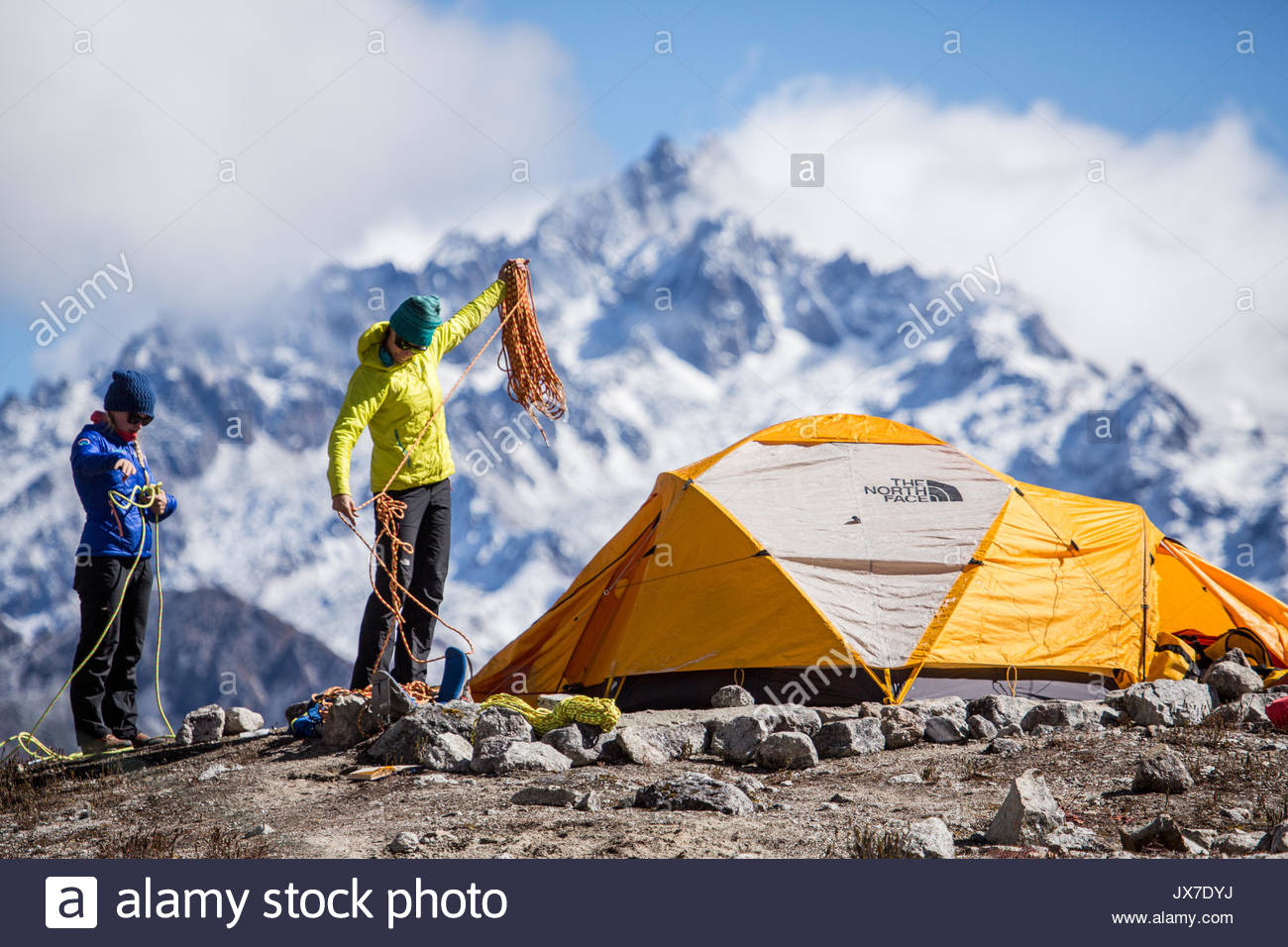 Expedition members check climbing ropes and gear prior to setting out on a mountaineering expedition. Stock Photo