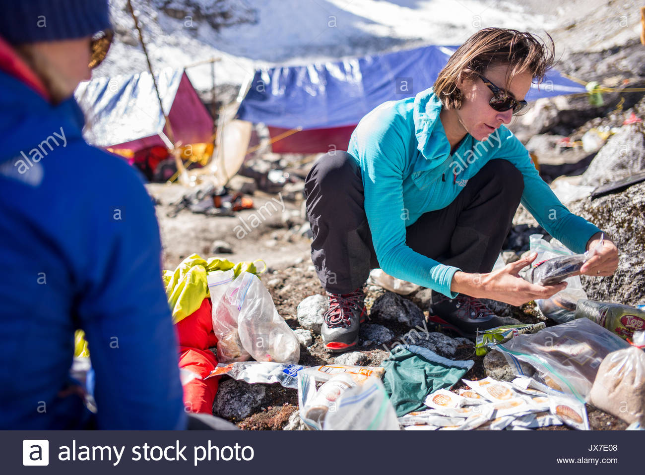 Expedition members check gear. - Stock Image