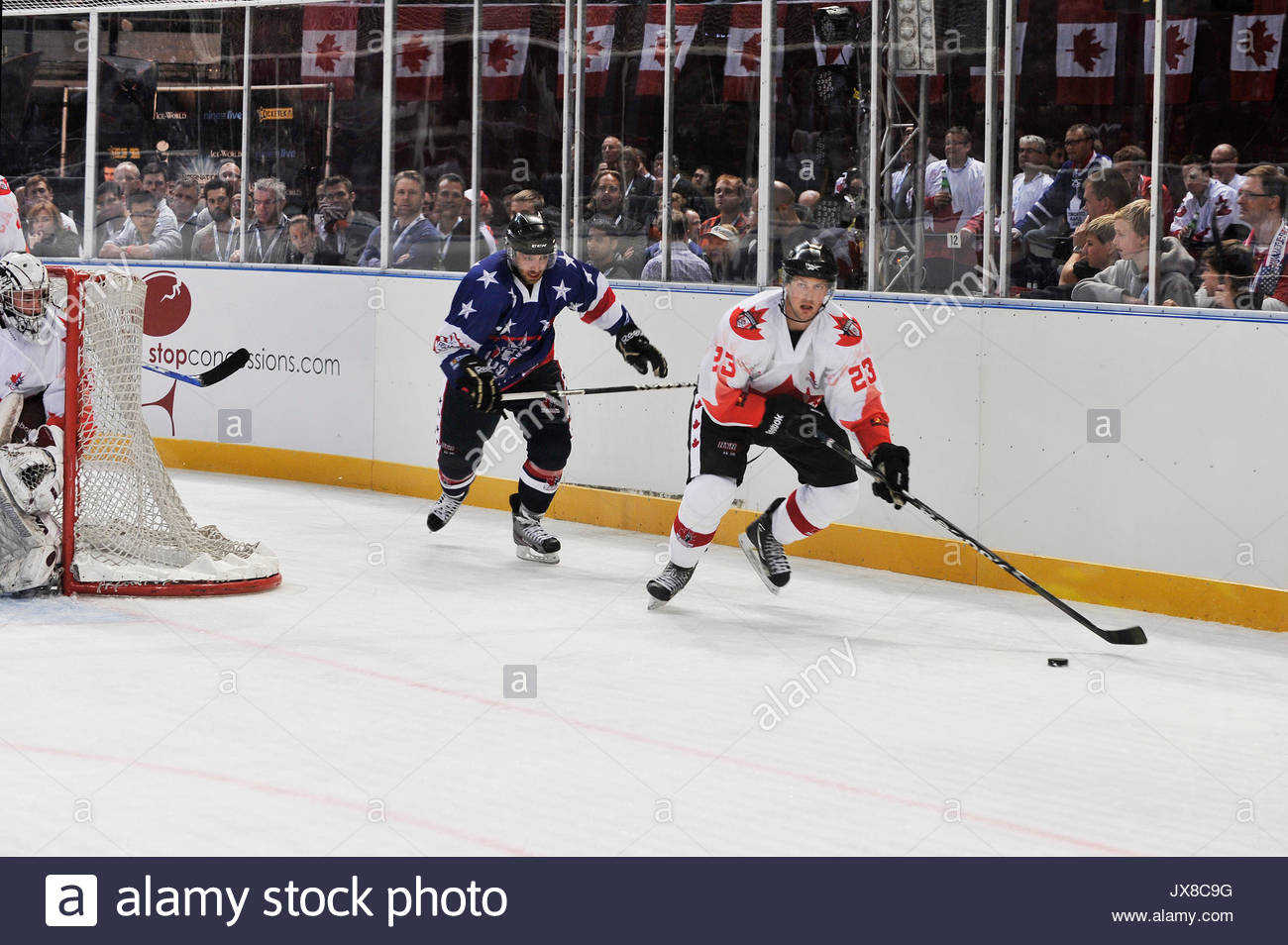 ece66e5d270 Kyle Bushee of Team USA attempts to catch TJ Fast of Team Canada. Leading ice  hockey players compete in the IIHT International Ice Hockey Tournament to  ...