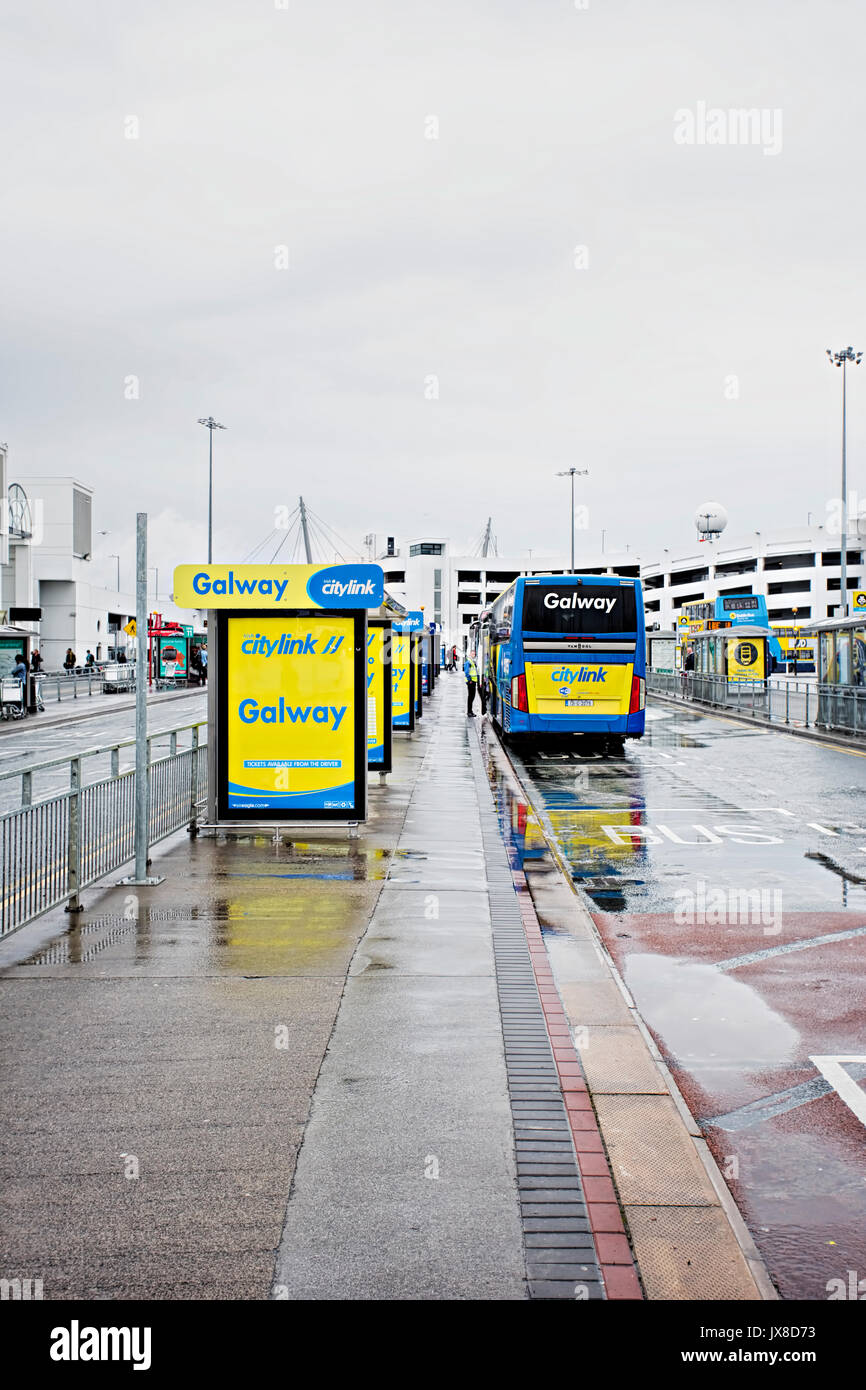 Irish City Link bus linking Dublin Galway Shannon Limerick & Cork airports waiting for passengers on the airport stop on rainy, summer day, Dublin, Ir - Stock Image