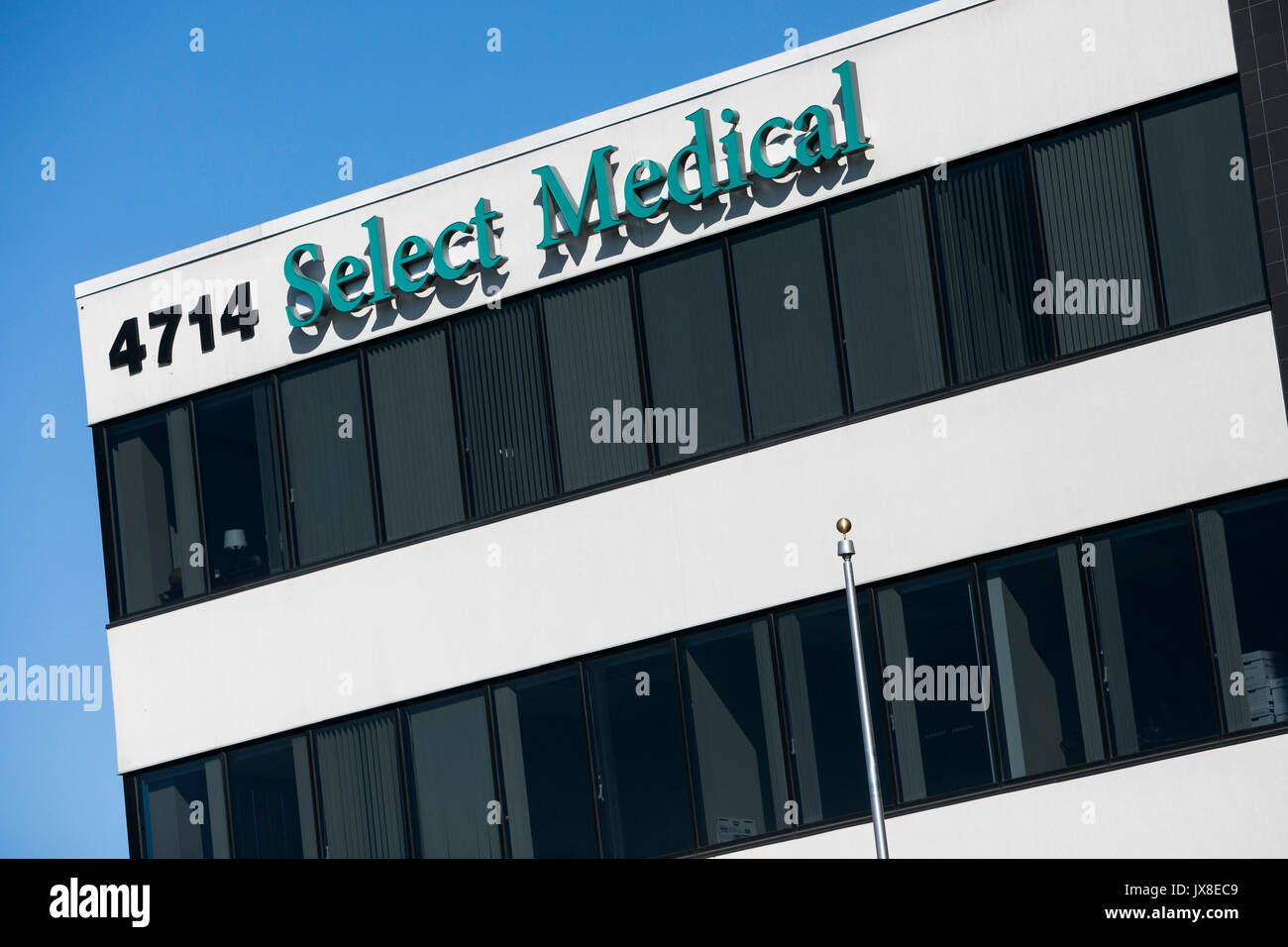 A logo sign outside of the headquarters of Select Medical in Mechanicsburg, Pennsylvania on July 30, 2017. - Stock Image